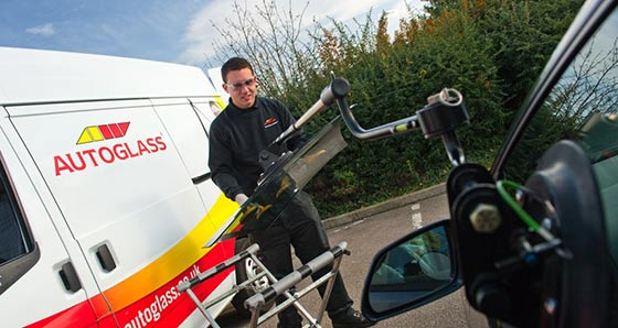 Autoglass technician carrying out a windscreen replacement